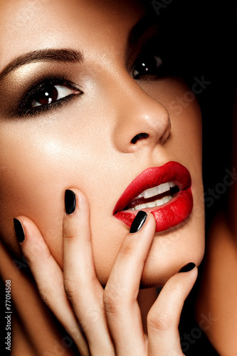 Beautiful young model with red lips. Gorgeous Woman Face.