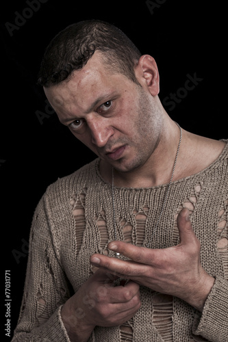 Fotografija  Frowning man portrait looking at camera on black