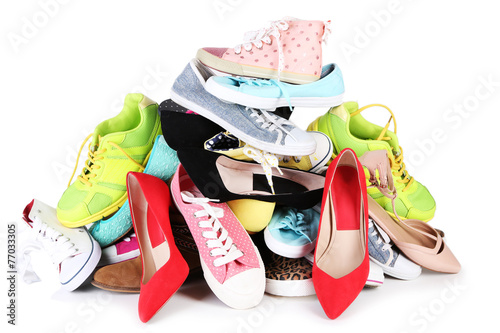 Fotografie, Obraz  Pile of various female shoes isolated on white