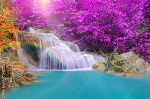 Wonderful Waterfall with rainbows in deep forest at national par © weerayut