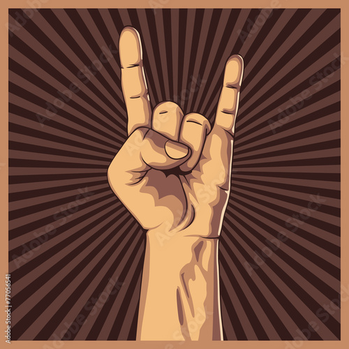 Valokuva  Hand in rock sign background.