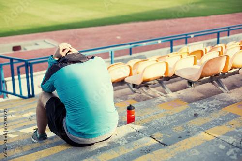 Fotografie, Obraz  tired sportsman after failing at stadium