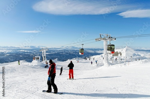 Skiers on the top of the piste Canvas Print