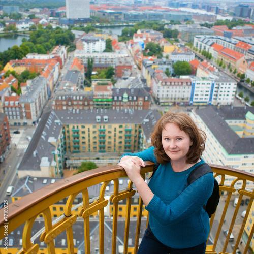 Photo  Girl on top of Vor Frelsers Kirke