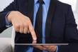 Businessman Touching Digital Tablet