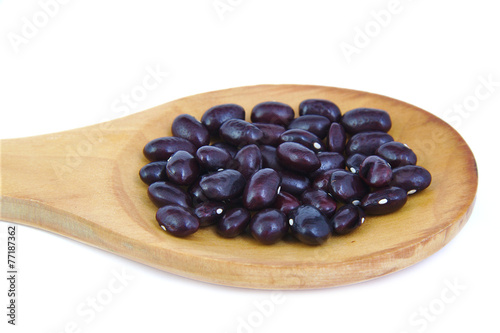 Uncoocked red beans on wooden spoon. Gernika beans. Poster
