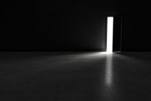 Open Door To Dark Room With Br...