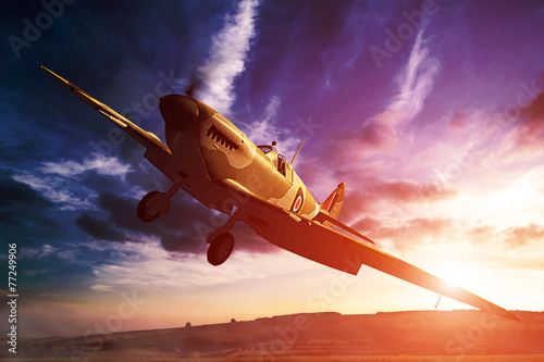 Fotografija  Supermarine Spitfire in fligjt with clouds during sunset