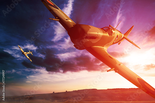 Canvas Supermarine Spitfire in fligjt with clouds during sunset