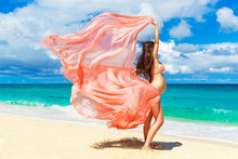 Young Pregnant Woman With Pink Cloth Fluttering In The Wind On A