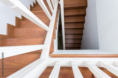 Foto op Plexiglas Trappen wooden staircase made from laminate wood in white modern house