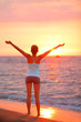 Happy freedom woman relaxing at beach sunset