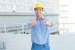 Male architect showing double thumbs up