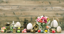 Easter Decoration With Pink Tulip Flowers And Colored Eggs
