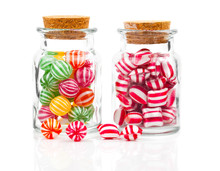 Two Filled Glass Candy Jars Is...