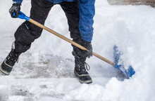 Man Removing Snow From His Driveway