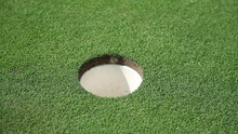 Hole And White Golf Ball