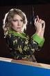 Beautiful blonde girl in military khaki shirt with gun