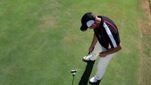 Man Golfer Hits White Golf Ball With Golf Club Top View