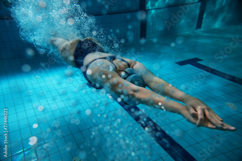 Photo  Female swimmer at the swimming pool.Underwater photo.