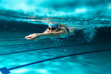 Female Swimmer At The Swimming...