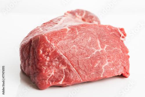 Valokuva  raw beef isolated on white background