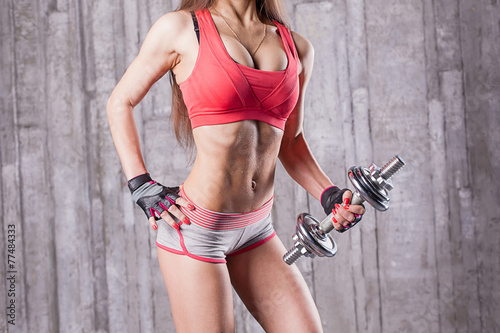 Fototapety, obrazy: Bodybuilder girl with dumbbell