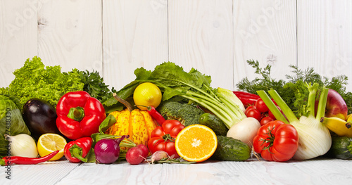 Fruit and vegetable borders on white wooden old table © ZoomTeam