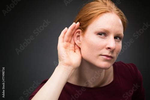 Photo  Curious Woman Listens to Rumors