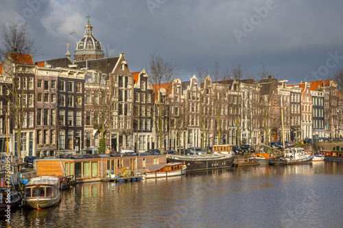 Photo  Canal houses and house boats in Amsterdam