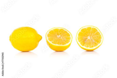 Yellow ripe lemon isolated on a white