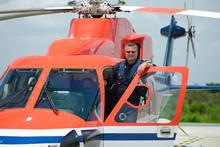 Offshore Helicopter Pilot Is Standing On Helicopter Cockpit