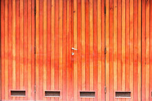 A Yellow,brown Wood Door