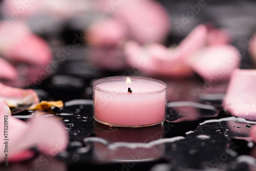 Poster Spa pink rose petals with pink candle and therapy stones