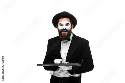 Photo  mime as a businessman holdinga keyboard