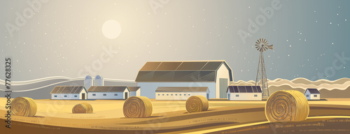 Rural landscape with bales of hay.