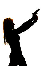 Silhouette Of A Woman Pointing A Gun To The Side Close
