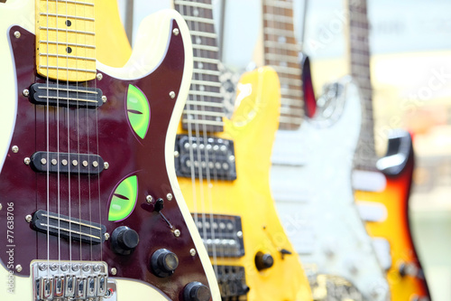Foto op Canvas Muziekwinkel Many electric guitars
