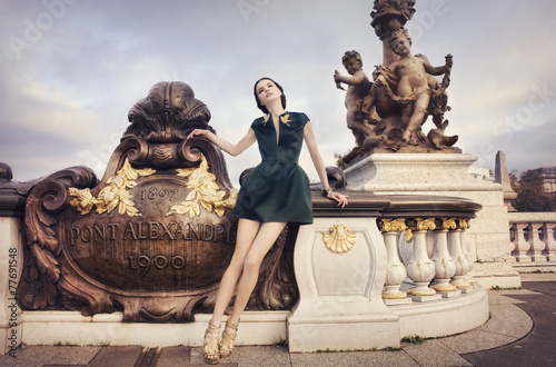 Платно Beautiful woman waiting on Alexandre Bridge, Paris, France