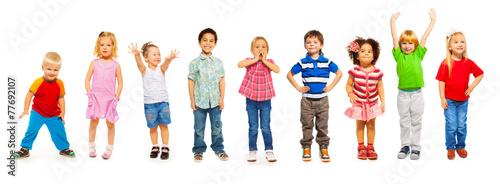 Valokuva  Combination of little kids standing isolated