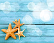 Beach. Starfish on blue wooden deck.