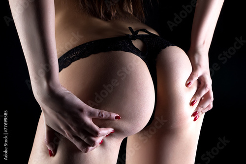 Poster Ezel Photo of woman with hands on buttocks