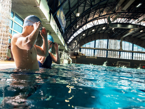 Swimmer at the swimming pool.Daily training. Wallpaper Mural