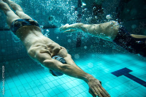 Photo  Swimmers at the swimming pool.Underwater photo.
