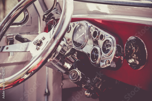 Foto  Interior of old vintage car. Vintage effect processing