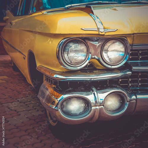 Old retro or vintage car front side. Vintage effect processing Canvas