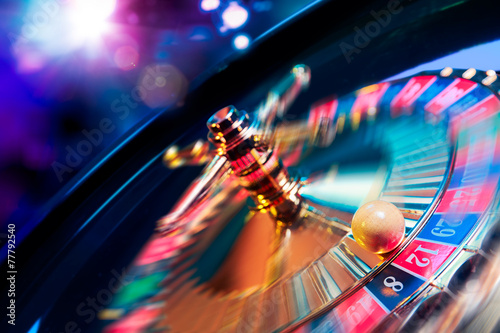 Fotografie, Obraz  Roulette wheel in motion with a bright and colorful background