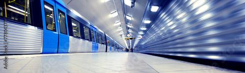 Leinwand Poster Train arriving to subway station platform