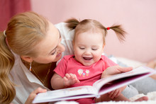 Happy Mother Read A Book To Ch...