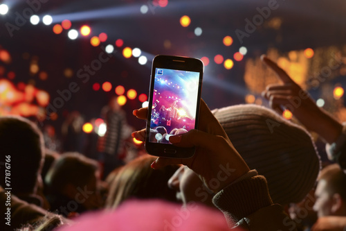 Fotografie, Obraz  People holding their smartphones and photographing concert